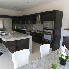 Contemporary Kitchen by Grupo AMMEX