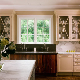 Eclectic kitchen in DC Metro with glass-front cabinets.