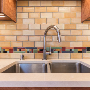 Design ideas for a large l-shaped eat-in kitchen in Minneapolis with a drop-in sink, shaker cabinets, brown cabinets, marble benchtops, multi-coloured splashback, terra-cotta splashback, stainless steel appliances, light hardwood floors, with island, beige floor and beige benchtop.