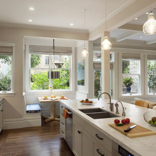 Kitchen - traditional kitchen idea in San Francisco with glass-front cabinets and stainless steel appliances