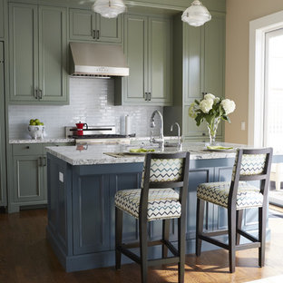 Inspiration for a mid-sized traditional galley eat-in kitchen in San Francisco with an undermount sink, recessed-panel cabinets, blue cabinets, granite benchtops, white splashback, glass tile splashback, stainless steel appliances, medium hardwood floors and with island.