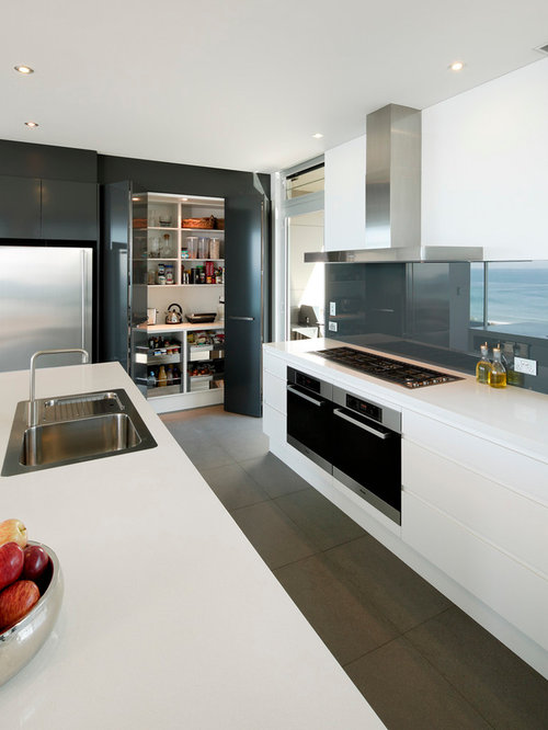 Trendy kitchen photo in Sydney with a drop-in sink flat-panel cabinets & Bifold Cabinet Doors | Houzz kurilladesign.com