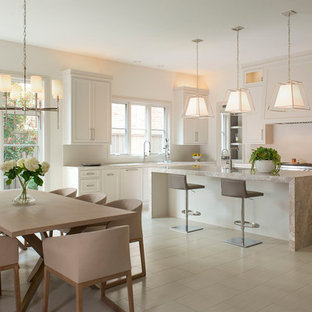 Transitional eat-in kitchen ideas - Eat-in kitchen - transitional eat-in kitchen idea in Dallas with an undermount sink, shaker cabinets, beige cabinets and an island