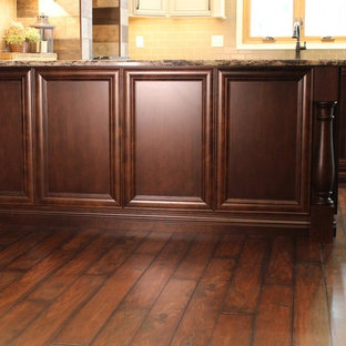 Inspiration for a large traditional u-shaped eat-in kitchen in Chicago with a farmhouse sink, flat-panel cabinets, beige cabinets, quartz benchtops, brown splashback, ceramic splashback, stainless steel appliances, vinyl floors and with island.
