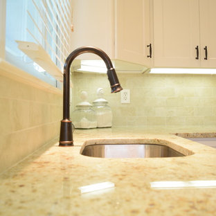 Colonial cream granite countertops with oil rubbed bronze goose neck faucet