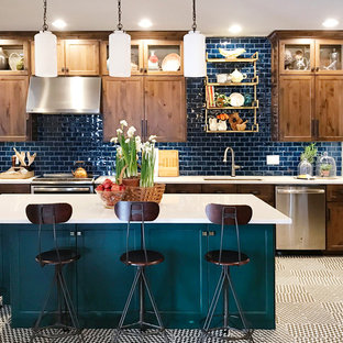 Inspiration for a mid-sized traditional kitchen in Other with an undermount sink, quartzite benchtops, blue splashback, subway tile splashback, stainless steel appliances, with island, multi-coloured floor, shaker cabinets and dark wood cabinets.