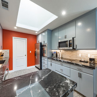 Inspiration for a mid-sized asian u-shaped open plan kitchen in Other with an integrated sink, flat-panel cabinets, blue cabinets, granite benchtops, multi-coloured splashback, matchstick tile splashback, stainless steel appliances, cork floors, a peninsula, multi-coloured floor and black benchtop.