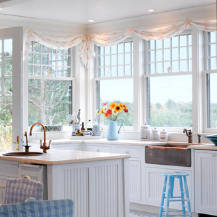 Design ideas for a beach style eat-in kitchen in Boston with a farmhouse sink, shaker cabinets and white cabinets.