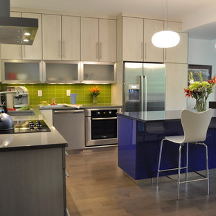 Design ideas for a large contemporary l-shaped open plan kitchen in Denver with flat-panel cabinets, beige cabinets, green splashback, stainless steel appliances, a submerged sink, engineered stone countertops, metro tiled splashback, dark hardwood flooring, an island and beige floors.
