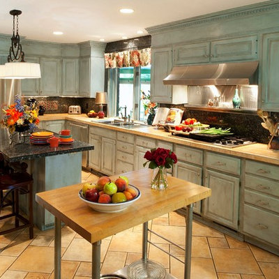 Inspiration for a large eclectic u-shaped ceramic tile open concept kitchen remodel in Cleveland with a double-bowl sink, raised-panel cabinets, blue cabinets, tile countertops, blue backsplash, stone tile backsplash, stainless steel appliances and an island