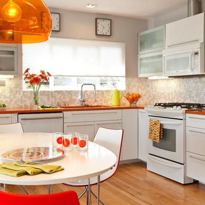 1950s eat-in kitchen photo in Other with mosaic tile backsplash, flat-panel cabinets, white cabinets, quartz countertops, beige backsplash, white appliances and orange countertops
