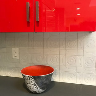 Inspiration for a large contemporary u-shaped light wood floor eat-in kitchen remodel in San Francisco with an undermount sink, flat-panel cabinets, red cabinets, quartz countertops, white backsplash, ceramic backsplash, stainless steel appliances and an island