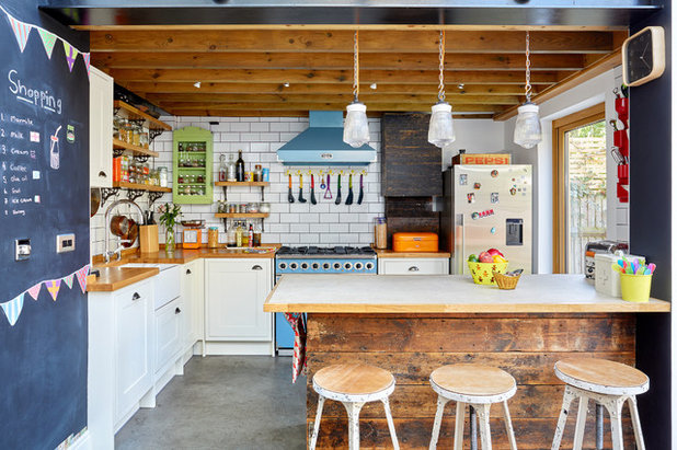 Houzz tour a colourful and creative family home in north for Avocado kitchen cabinets