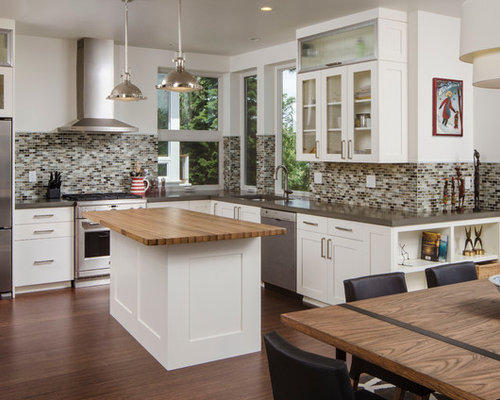 Example Of A Trendy L Shaped Eat In Kitchen Design In Seattle With Concrete