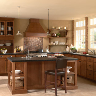 Photo of a large country l-shaped eat-in kitchen in Orange County with medium wood cabinets, with island, a drop-in sink, shaker cabinets, solid surface benchtops, metallic splashback, metal splashback, stainless steel appliances, ceramic floors and beige floor.