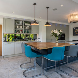 Inspiration for a traditional kitchen in Cheshire with a submerged sink, shaker cabinets, grey cabinets, black appliances, an island, grey floors and white worktops.