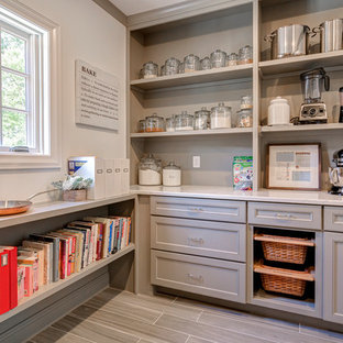Large transitional kitchen pantry in Columbus with recessed-panel cabinets, grey cabinets, grey splashback and porcelain floors.