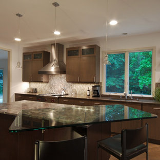 Design ideas for a large midcentury single-wall eat-in kitchen in Detroit with an undermount sink, flat-panel cabinets, medium wood cabinets, glass benchtops, multi-coloured splashback, glass tile splashback, stainless steel appliances, medium hardwood floors and with island.