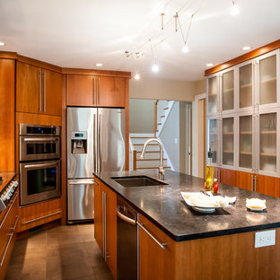 Mid-sized modern eat-in kitchen ideas - Inspiration for a mid-sized modern l-shaped porcelain floor eat-in kitchen remodel in Boston with stainless steel appliances, an undermount sink, flat-panel cabinets, medium tone wood cabinets, granite countertops, multicolored backsplash, glass tile backsplash and an island