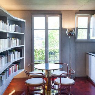 Cette image montre une cuisine américaine linéaire minimaliste de taille moyenne avec un plan de travail en béton, un évier 1 bac, des portes de placard grises et aucun îlot.