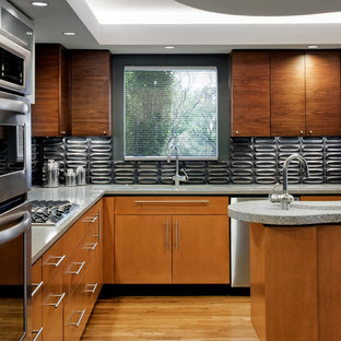 Inspiration for a modern l-shaped kitchen remodel in Austin with an undermount sink, flat-panel cabinets, medium tone wood cabinets, gray backsplash and stainless steel appliances