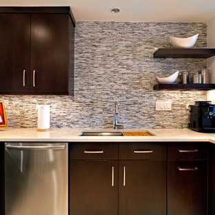 Contemporary eat-in kitchen designs - Example of a trendy u-shaped beige floor eat-in kitchen design in Nashville with stainless steel appliances, an undermount sink, flat-panel cabinets, dark wood cabinets, multicolored backsplash, quartz countertops, mosaic tile backsplash, white countertops and no island