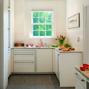 Trendy u-shaped kitchen photo in DC Metro with an undermount sink, flat-panel cabinets, white cabinets, white backsplash, subway tile backsplash and paneled appliances