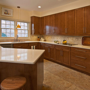 Eat-in kitchen - large contemporary u-shaped linoleum floor eat-in kitchen idea in St Louis with shaker cabinets, stainless steel appliances, quartz countertops, an undermount sink, brown cabinets, beige backsplash, ceramic backsplash and a peninsula