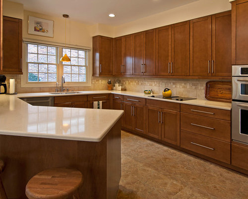 Silestone tigris sand houzz for Angled kitchen cabinets