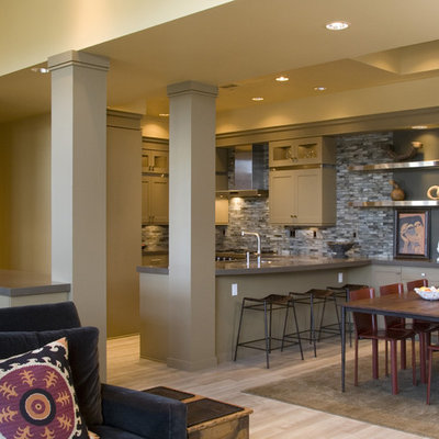 Example of an eclectic u-shaped open concept kitchen design in Portland with shaker cabinets and beige cabinets