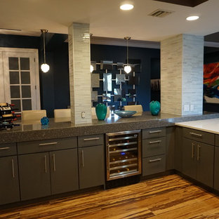 Photo of a mid-sized modern open plan kitchen in Tampa with an undermount sink, glass-front cabinets, grey cabinets, recycled glass benchtops, grey splashback, matchstick tile splashback, stainless steel appliances, vinyl floors, a peninsula and brown floor.