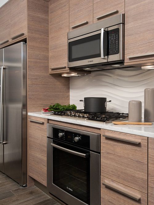 small trendy galley kitchen photo in dc metro with flatpanel cabinets medium tone