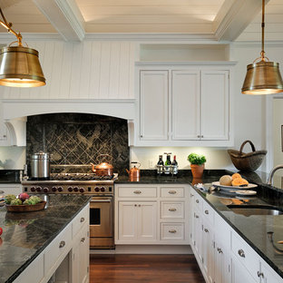 Inspiration for a timeless eat-in kitchen remodel in New York with recessed-panel cabinets, white cabinets, granite countertops, stainless steel appliances, an undermount sink and black backsplash