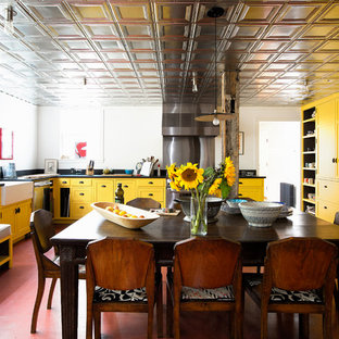 Eat-in kitchen - farmhouse eat-in kitchen idea in Bridgeport with a farmhouse sink, shaker cabinets, yellow cabinets, metallic backsplash, stainless steel appliances and no island