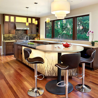 Large transitional medium tone wood floor and beige floor kitchen photo in San Francisco with stainless steel appliances, an undermount sink, recessed-panel cabinets, medium tone wood cabinets, quartz countertops, stone slab backsplash, an island and black backsplash