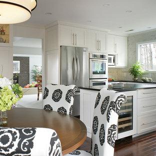 Huge transitional u-shaped dark wood floor eat-in kitchen photo in Newark with & White Cabinets Dark Backsplash | Houzz