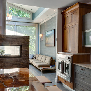 This is an example of a large transitional galley eat-in kitchen in New York with shaker cabinets, medium wood cabinets, onyx benchtops, stainless steel appliances, porcelain floors and with island.