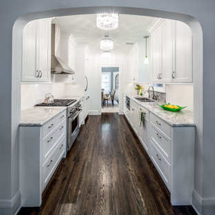 This is an example of a medium sized traditional galley enclosed kitchen in Minneapolis with a submerged sink, shaker cabinets, white splashback, white cabinets, granite worktops, metro tiled splashback, dark hardwood flooring, no island and brown floors.