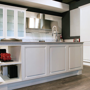 Mid-sized trendy single-wall medium tone wood floor kitchen pantry photo in San Diego with a double-bowl sink, flat-panel cabinets, white cabinets, quartzite countertops, white backsplash, ceramic backsplash, paneled appliances and an island