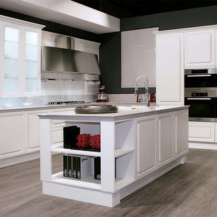 Kitchen pantry - mid-sized contemporary single-wall medium tone wood floor kitchen pantry idea in San Diego with a double-bowl sink, flat-panel cabinets, white cabinets, quartzite countertops, white backsplash, ceramic backsplash, paneled appliances and an island