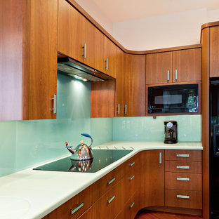Contemporary kitchen in Other with flat-panel cabinets, medium wood cabinets, glass sheet splashback and black appliances.