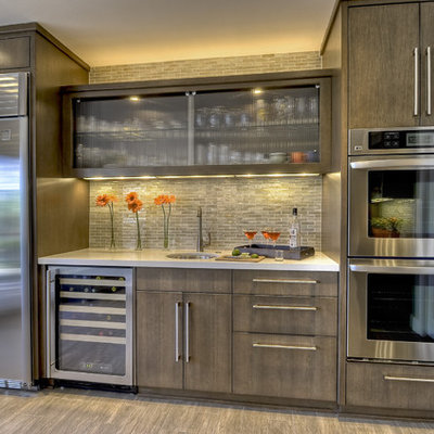 Huge trendy u-shaped porcelain tile eat-in kitchen photo in San Diego with stainless steel appliances, an undermount sink, flat-panel cabinets, gray cabinets, quartz countertops, white backsplash, glass tile backsplash and an island