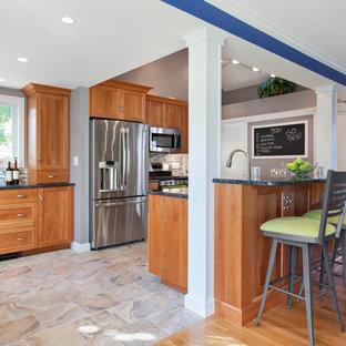 Elegant galley kitchen photo in Boston with shaker cabinets, medium tone wood cabinets, multicolored backsplash, matchstick tile backsplash and stainless steel appliances