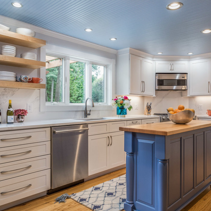 Kitchen - farmhouse l-shaped medium tone wood floor and brown floor kitchen idea in Boston with an undermount sink, recessed-panel cabinets, white cabinets, marble countertops, white backsplash, marbl