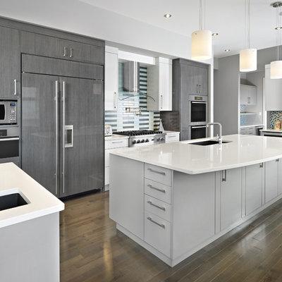 Trendy kitchen photo in Edmonton with paneled appliances