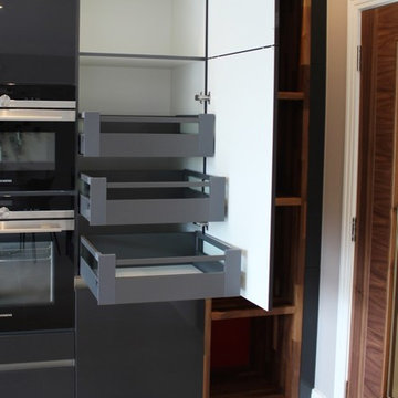 Contemporary dark grey kitchen with many storage solutions