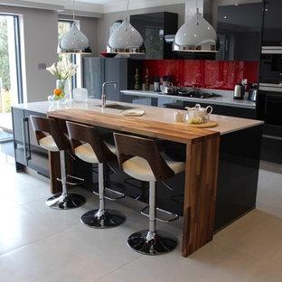 Contemporary dark grey kitchen with walnut breakfast bar