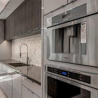 Contemporary open concept kitchen ideas - Example of a trendy l-shaped travertine floor and gray floor open concept kitchen design in Houston with flat-panel cabinets, gray cabinets, marble countertops, gray backsplash, marble backsplash, stainless steel appliances, two islands and gray countertops