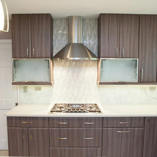 Mid-sized contemporary eat-in kitchen designs - Eat-in kitchen - mid-sized contemporary u-shaped porcelain floor eat-in kitchen idea in Chicago with an undermount sink, flat-panel cabinets, gray cabinets, quartz countertops, gray backsplash, stone tile backsplash, stainless steel appliances and an island