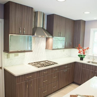 Mid-sized contemporary eat-in kitchen designs - Example of a mid-sized trendy u-shaped porcelain floor eat-in kitchen design in Chicago with an undermount sink, flat-panel cabinets, gray cabinets, quartz countertops, gray backsplash, stone tile backsplash, stainless steel appliances and an island